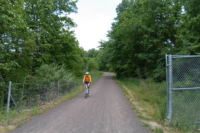Schuylkill River Trail Schuylkill River Trail Cyclist descending a gentle slope into the old Phoenix Iron & Steelworks property in Phoenixville.