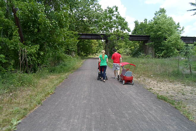 Schuylkill River Trail Schuylkill River Trail This couple was taking their young children on a stroll near the old RR trestle in Phoenixville. Taken May 2015.