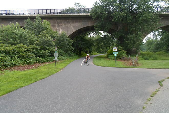 Schuylkill River Trail Schuylkill River Trail Cyclist rounding the bend at the junction with the Perkiomen Trail in Oaks. Taken July 2015.