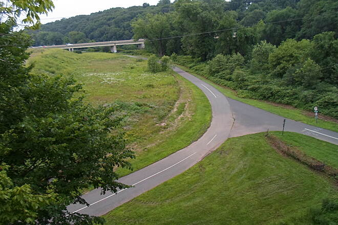 Schuylkill River Trail Schuylkill River Trail Bird's eye view of the junction between the Schuylkill River Trail, which curves from right to left, and the Perkiomen Trail, which heads north under the Route 422 bridges, as seen from the restored RR trestle in Oaks.