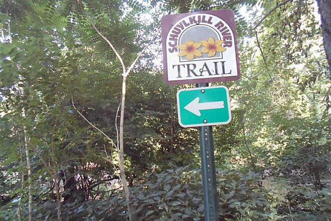 Schuylkill River Trail Thun Trail Sign pointing the way in Pottstown's Riverfront Park.