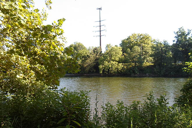 Schuylkill River Trail Thun Trail Combination electrical and cell phone tower visible across the Schuylkill in Pottstown. Taken July 2014.
