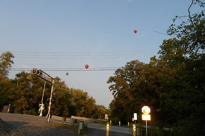 Schuylkill River Trail Thun Trail Three hot-air balloons could be seen soaring through the summer evening skies near Squirrel Hollow Road west of Pottstown. Taken August 2014.