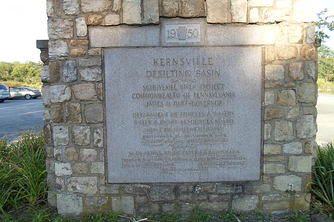 Schuylkill River Trail Bartram Trail Located at the Kernsville Dam Trailhead, this stone monument commemorates the site's past use as a basin that removed coal silt from the Schuylkill River. Taken August 2014.
