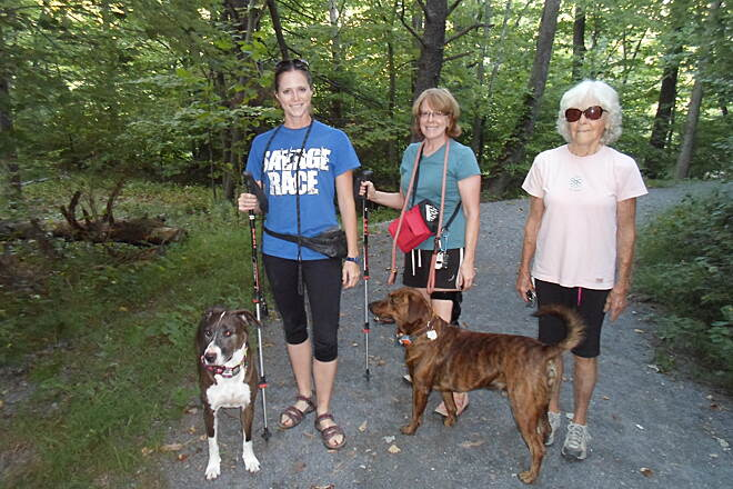 Schuylkill River Trail Bartram Trail Three generations of women (right to left; grandmother, daugther and granddaughter) and their dogs enjoy a stroll on the Therman Maderia/Cabelas' Wetlands segment north of Hamburg.