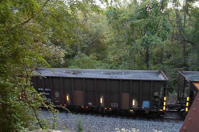 Schuylkill River Trail Bartram Trail Coal trains can often be seen running along the active rail line that parallels the trail for much of its length. This photo was taken just south of the Warren Trestle. Taken at dusk in Aug. 2014.