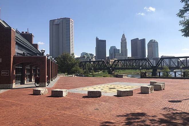 Scioto Greenway Trail North Bank Park Pavilion View of Downtown This is the pavilion at North Bank Park. The Scioto Greenway Trail runs below this plaza. If you head east, you'll head toward downtown; heading west will lead to the Camp Chase Trail.  October 2019