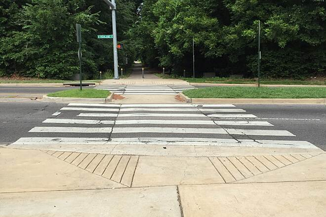 Shelby Farms Greenline trail crosses roads but has bike crossing signal