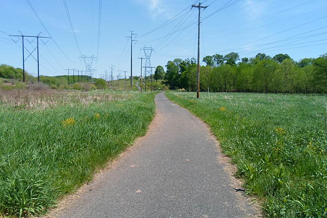 Skippack Trail Skippack Trail Here, you can see how the trail follows the powerline corridor up the hill in the distance. Taken May 2015.