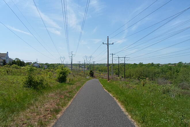 Skippack Trail Skippack Trail Another panoramic view looking west along the trail in the utility corridor. Taken May 2015.