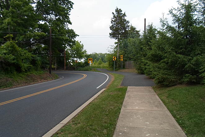 Skippack Trail Skippack Trail The trail's surface changes from asphalt to sidewalk-style concrete along Creamery Road. This is no problem for foot traffic, but cyclists might want to switch to the side of the road. Taken June 2015.