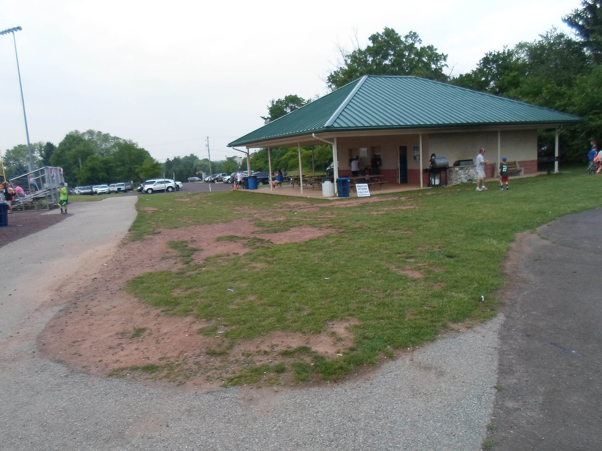 Skippack Trail Skippack Trail Curving around the concession stand and ballfield in Palmer Park. Trail users who pass by here during a baseball game can stop for low cost, but tasty, hamburgers, hot dogs and snacks.