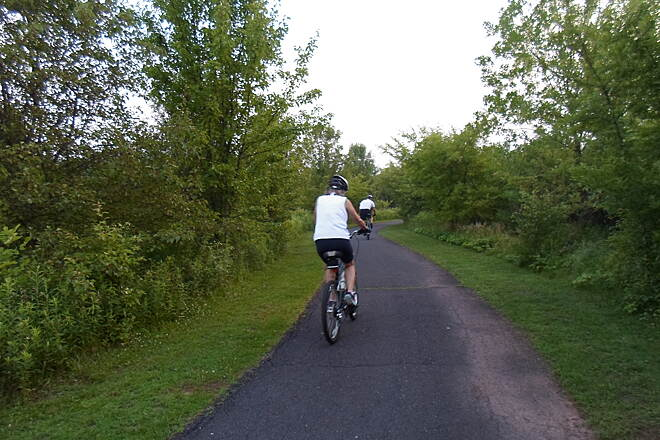 Skippack Trail Skippack Trail Cyclists riding along the trail through the 'wild' south side of Palmer Park. Taken June 2015.