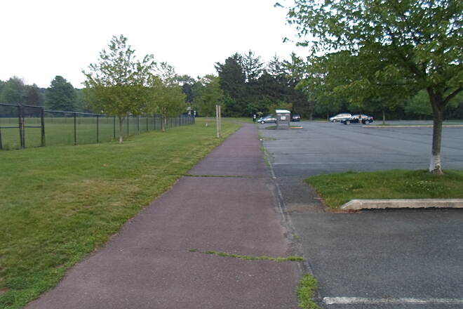 Skippack Trail Skippack Trail The trail is situated between a parking lot (right) and athletic fields (left) on the south edge of Palmer Park. Taken June 2015.