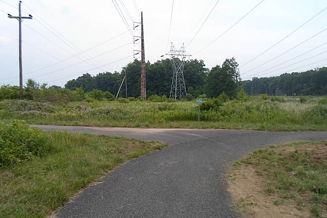 Skippack Trail Skippack Trail The trail splits again between Meetinghouse and Evansburg roads. The main greenway goes east toward Evansburg State Park, while the branch to the left heads north toward Kratz Road. Taken June 2015.