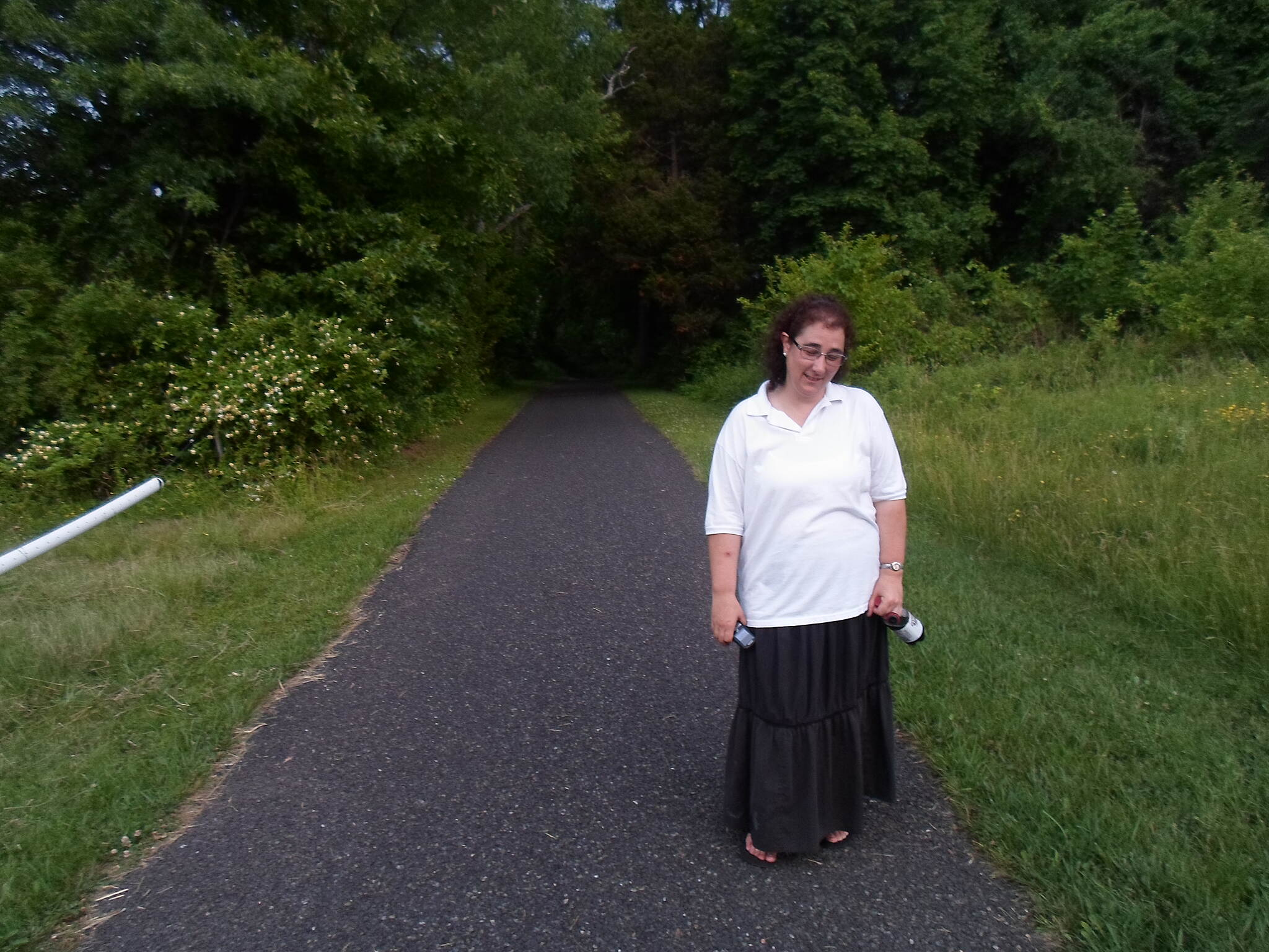 Skippack Trail Skippack Trail This woman was enjoying en evening stroll on the portion of the trail between Mensch and Creamery roads. Taken June 2015.