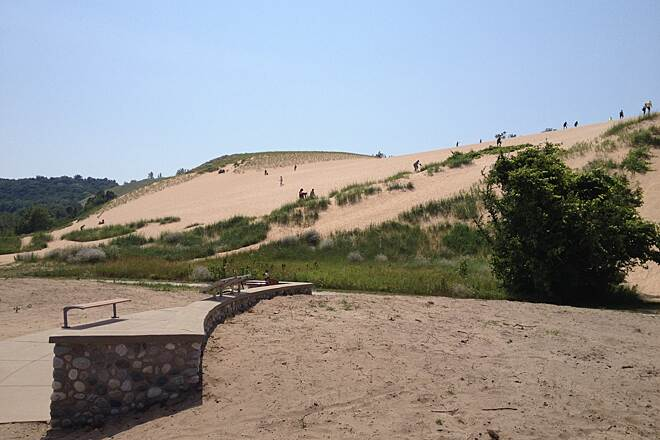 Sleeping Bear Heritage Trail Dune Climb 7/2014 Trail passes through the 'Dune Climb' area of the Park. For the Stout at Heart, Once you climb to the top, which is NOT in this picture, you can hike 2 miles over the Dunes to Lake Michigan. The VIEW will not disappoint.