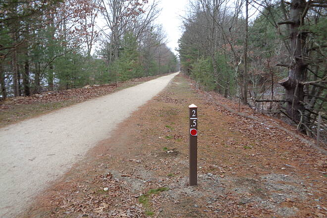 Southern New England Trunkline Trail Trail west at MP 2.5 Trail looking west along new stone dust surface at MP 2.5 just west of Lake St., Bellingham, MA 1/8/16.