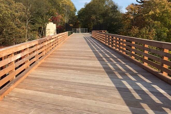 Southern New England Trunkline Trail New bridge 10-17-16 The new bridge over the existing rail line and Blackstone River is all but complete