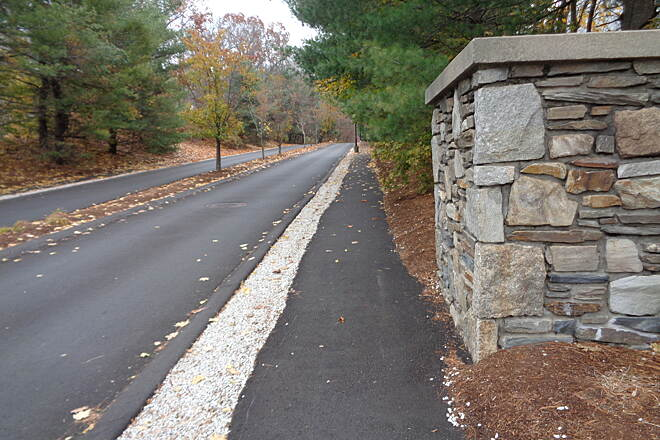 Southern New England Trunkline Trail View east along Castle Hill Wy This is the view east along Castle Hill Way from Rte. 122 in Blackstone, MA on 11/16/14. The entrance way is posted against trespassing, but the Mass. DCR has a legal right of way along the sidewalk for the SNETT.