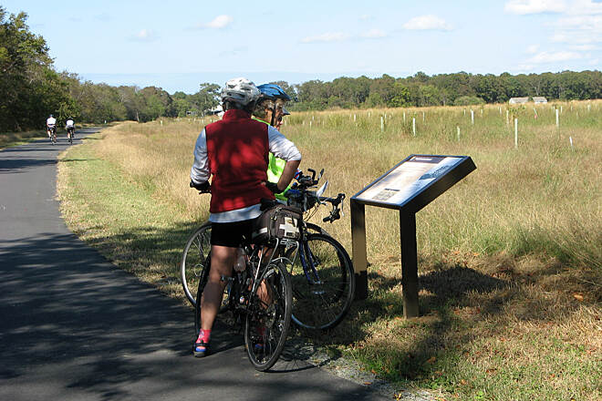 Southern Tip Bike & Hike Trail Riding/reading about wildlife Cyclists riding the trail and reading the interpretive signs along the route.
