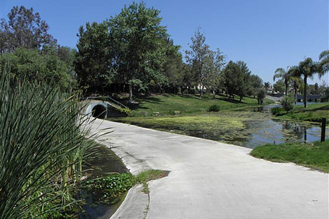 State Route 56 Bike Path  Trail crosses a stream next to a golf course.