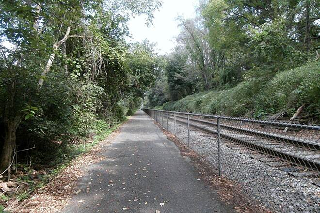 T. J. Evans Panhandle Trail Trail Trees, the trail, the chain link fence, the tracks....