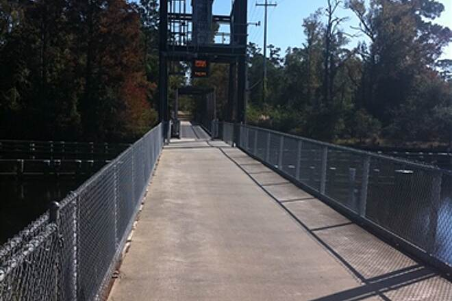 Tammany Trace Bridge at Lacombe Draw bridge opens at dawn and closes at dusk.  Time is posted of when bridge will close so be sure to cross it before it's too late!