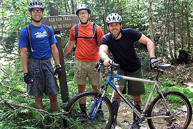 Tea Creek Trails Starting out on a muddy trail Christopher, Jeff and Dana of www.outdoortravels.com prepare to ride Red Run Loop.