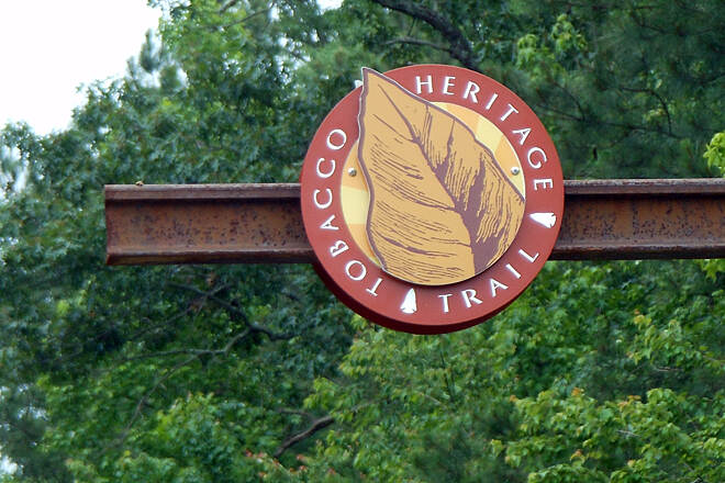 Tobacco Heritage Trail Trail symbol mounted on a rail section