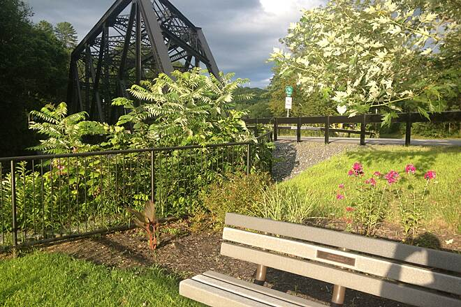 Toonerville Rail-Trail Trestle seen from garden A picture of the Springfield Garden Club's lovely garden, near the trestle on Paddock Road.