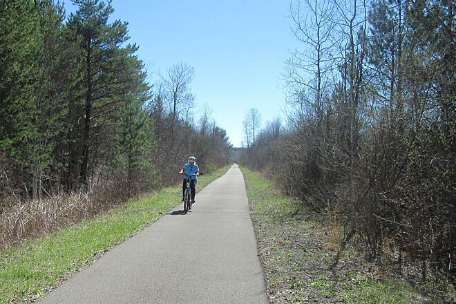 Trout Island Trail Cyclist on the trail Nice paved flat trail great for cycling
