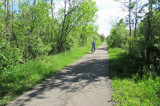 Trout Island Trail Biking along the trail May 2019 cyclist along the trail.
