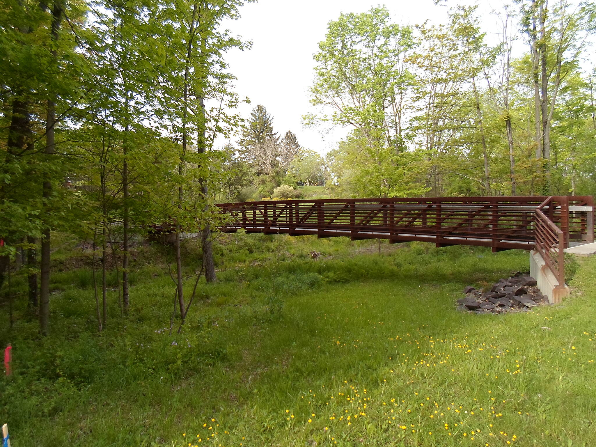 Unami Creek Trail Unami Creek Trail Footbridge over Unami Creek; this branch of the trail heads north toward a nearby development and connects to a nearby park.