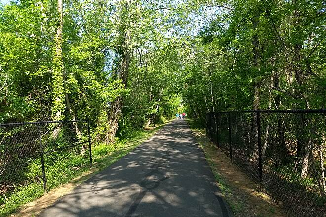Warrenton Branch Greenway Well-canopied trail The paved, tree-lined trail pathway provides a pleasant place to walk.