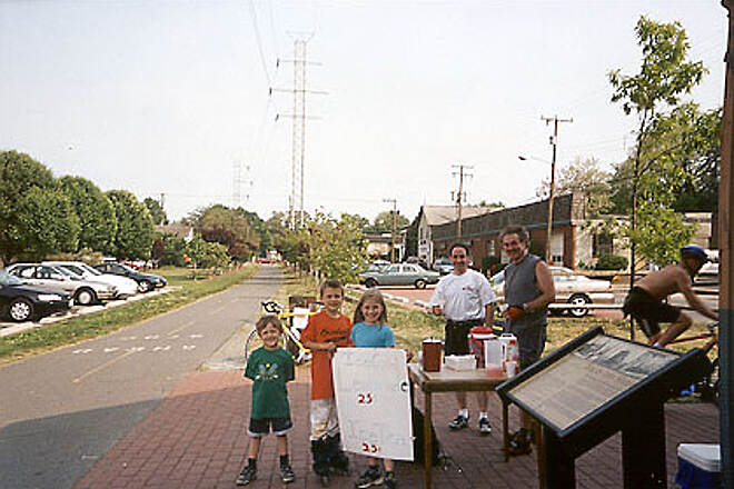 Washington and Old Dominion Railroad Regional Park (W&OD)   Amy (11), Andrew (9), and Matty (6) Cooper of Vienna, VA sell Iced Tea and Lemonade to thirsty trail users.