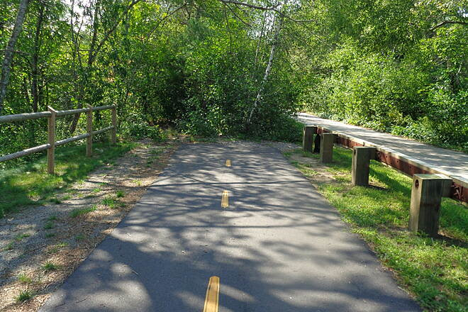 Washington Secondary Bike Path Current end of trail, Summit Looking west to the current west end of the bike path at Summit, RI. 9/4/16. You can continue west on rough trail by following Railroad St. to the right of the railing.