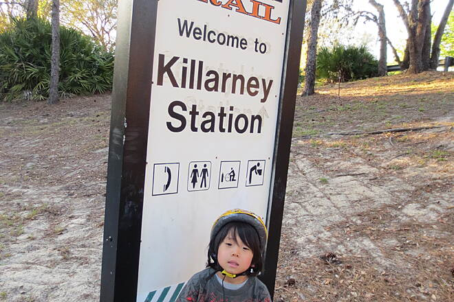 West Orange Trail Killarney Station My six year old son stands proudly in front of the Killarney Station sign on the West Orange Trail after biking six miles of the trail--quite an accomplishment considering that he removed the training wheels from his 12.5 inch wheels only the day before.