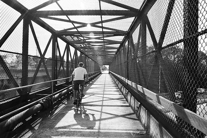 West Orange Trail Following my guy. Riding over the bridge on a sunny afternoon.