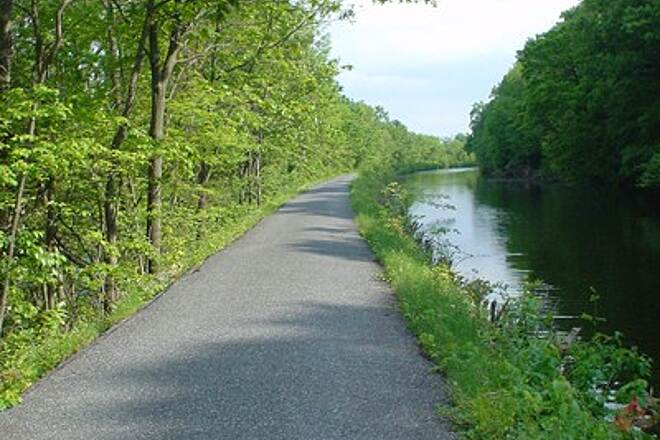 Windsor Locks Canal State Park Trail Typical Canal Path View Typical side view of the canal; drop offs to the canal and river are steep, but the pavement is in good shape.