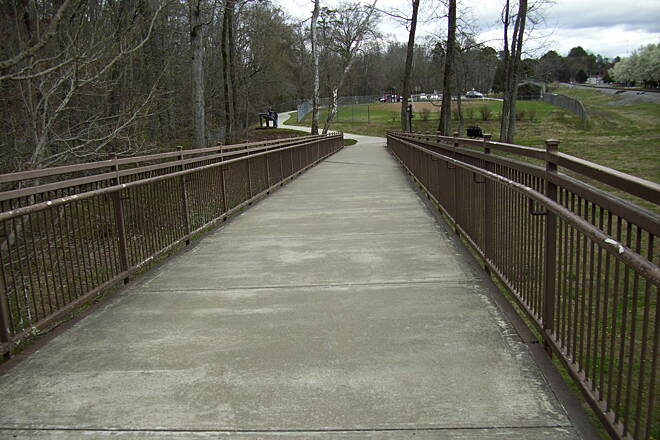 Wolftever Creek Greenway Leading to bridge. Ramp leading to bridge that crosses the creek.