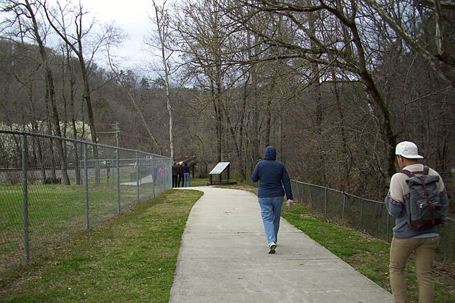 Wolftever Creek Greenway Path to map (granite slab) Path leading to map and bridge.