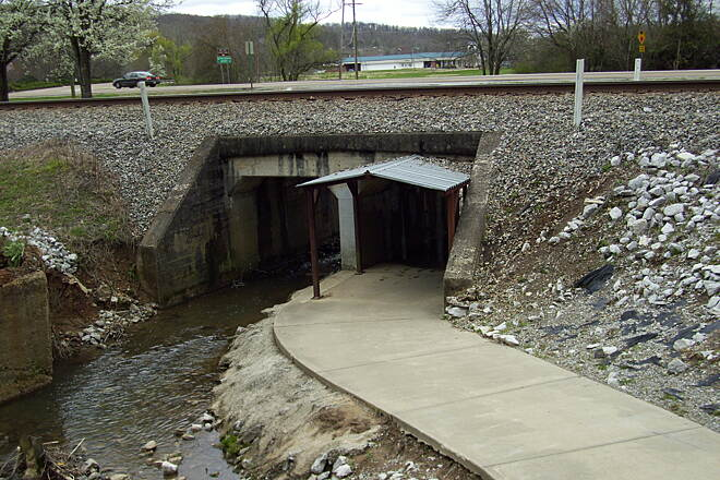 Wolftever Creek Greenway Under highway passage A side path leading to the college on the other side of the road.