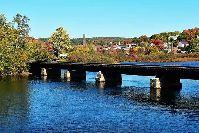 WOW Trail Laconia A view of the railroad over the water & Laconia in the background.